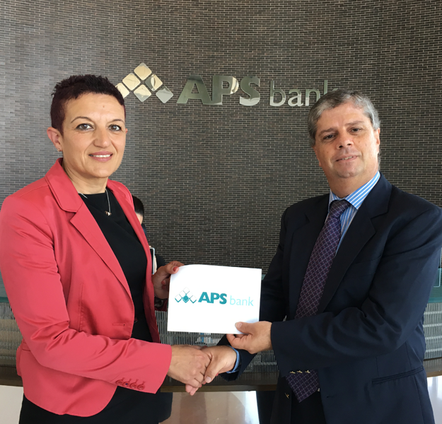 Mr Joe Farrugia (Senior Compliance Officer) presenting the tickets to Ms Cassar