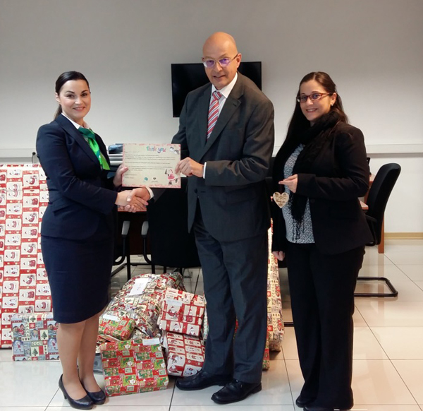 Members of APS Bank's Social Activities Committee, Diana Borg Briffa (left) and Janice Harvey (right) presenting a donation to Alfred Grixti (centre), Chairman of the Foundation of Social Welfare Services