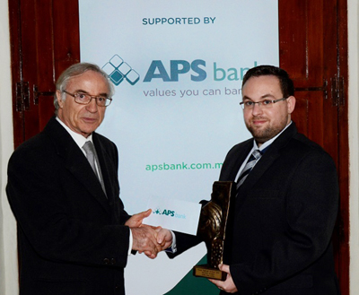 APS Bank Chairman, E.P. Delia congratulating the 'Youth of the Year', James Borg Cumbo