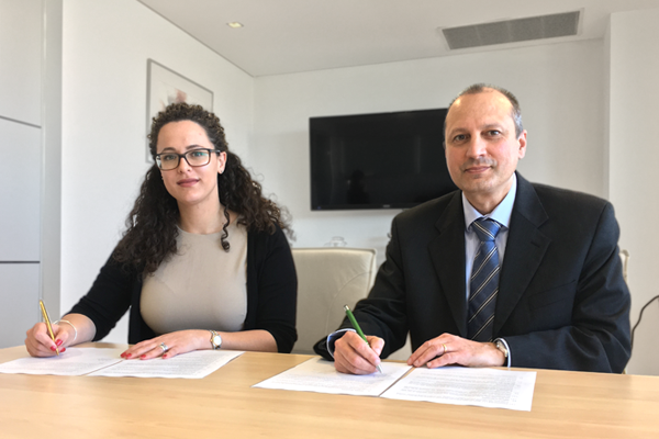 Malta Microfinance Chairperson, Christina Lejman and APS Bank's Chief Financial Officer, Noel Mc Carthy, signing the memorandum of understanding