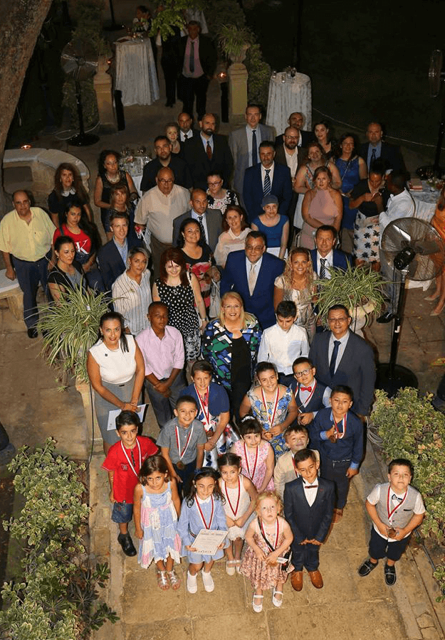 Group photo of H. E. President Marie-Louise Coleiro Preca together with children and parents, representatives of the school and sponsors